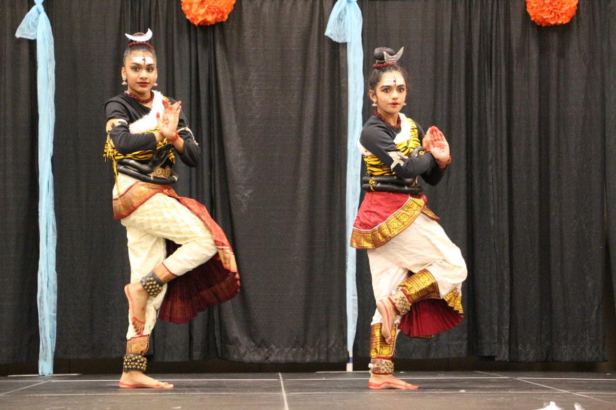 Two women culturally dancing